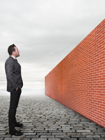 Man looking at brick wall Blog