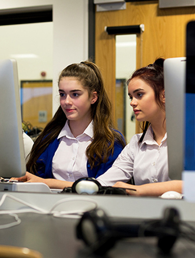 Two girls looking at a computer