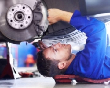 Car mechanic under car